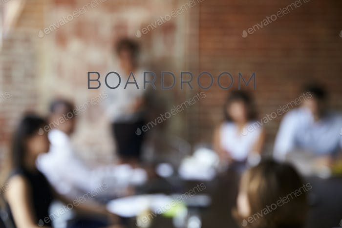 View Of Meeting Through Glass Door Labelled Boardroom