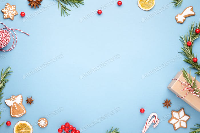 Blue Christmas Background Made of Gingerbread, Berries, Anis, Rosemary.