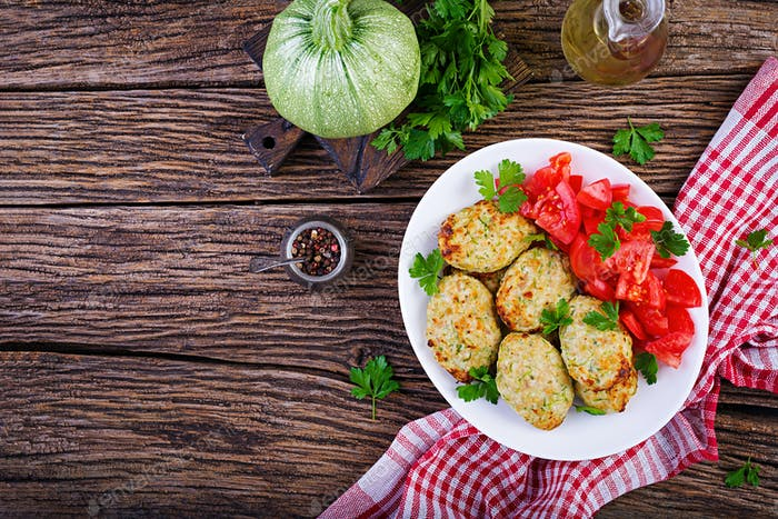 Chicken cutlet with zucchini and tomatoes salad. Healthy food. Top view