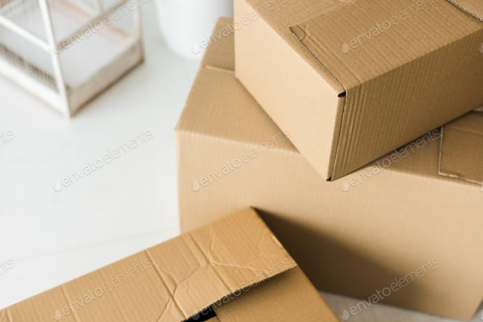 Brown cardboard boxes on light surface at home