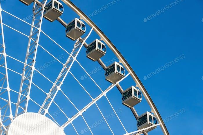 Closeup part of ferris wheel over the blur sky