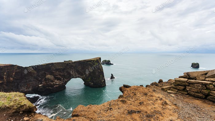 view of stone arch on Dyrholaey cliff in Iceland