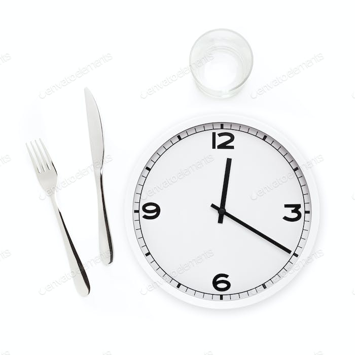 Fork, knife, glass, and white round clock