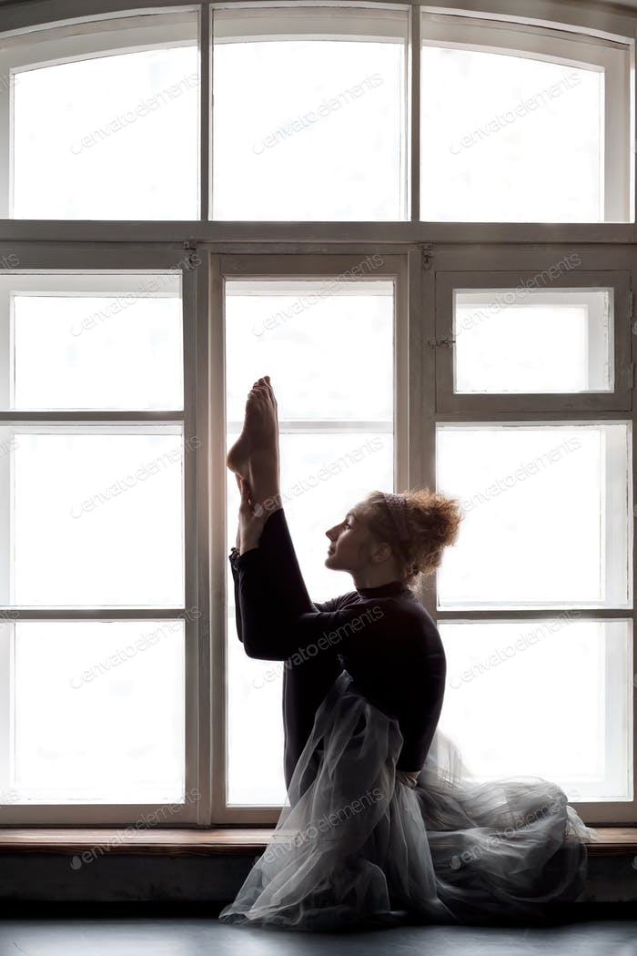 woman doing yoga exercise called Both Big Toes or Ubhaya Padangusthasana