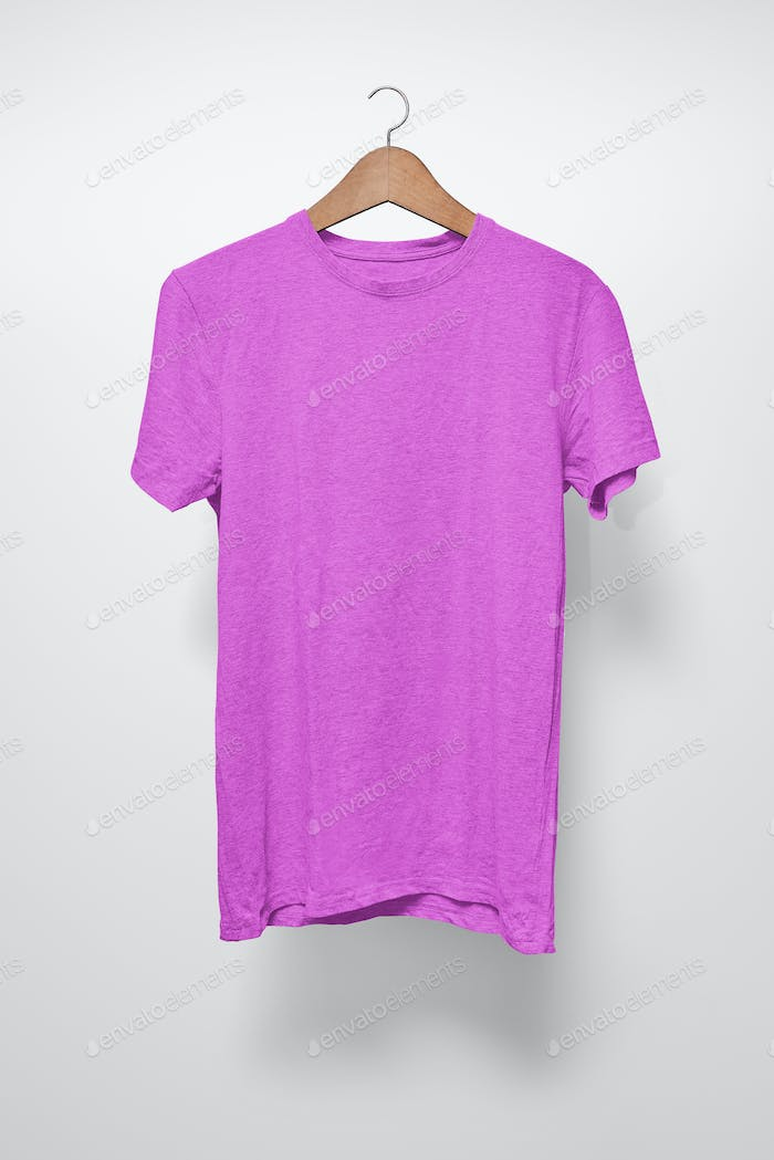 Purple T-Shirt on a hanger against a white background