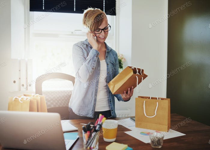 Motivated businesswoman placing orders on a phone
