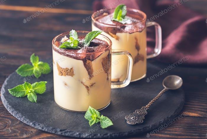 Two glass mugs of tiramisu
