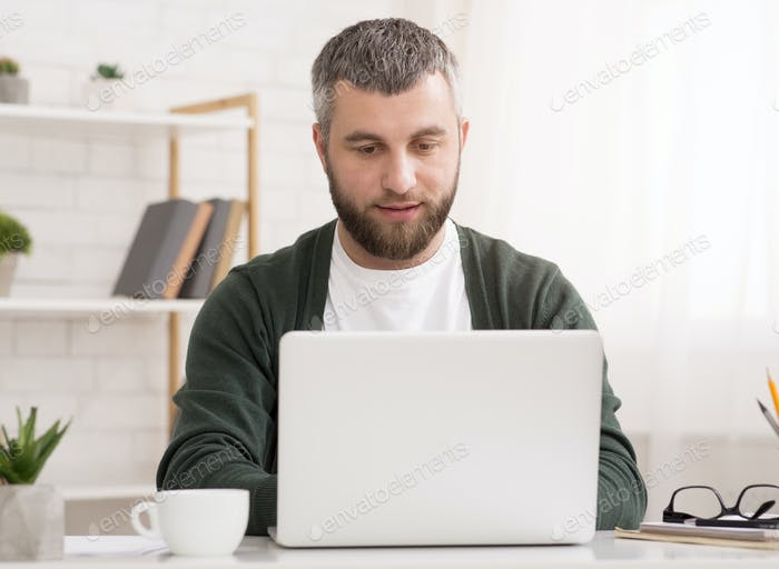 Portrait of concentrated businessman working from home