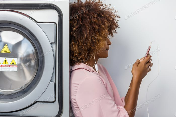 Young black African American woman waiting her clothes to be was