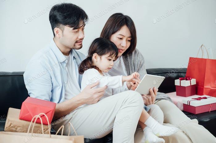 Happy family using ipad on festival day