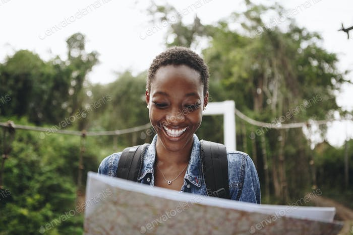 Happy woman navigating with a map