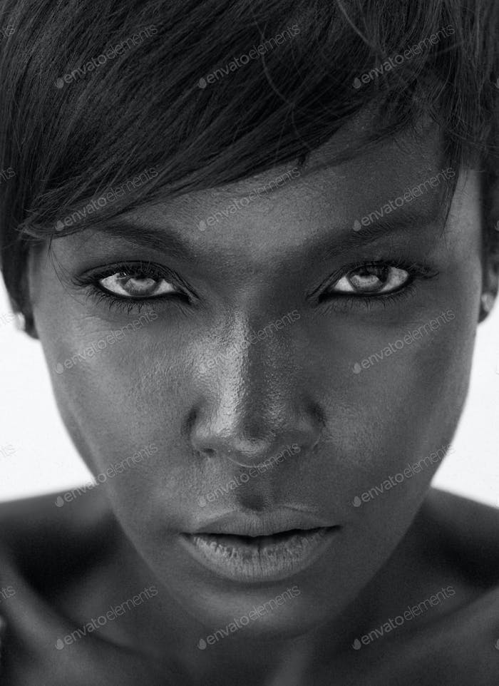 Beautiful african american woman staring