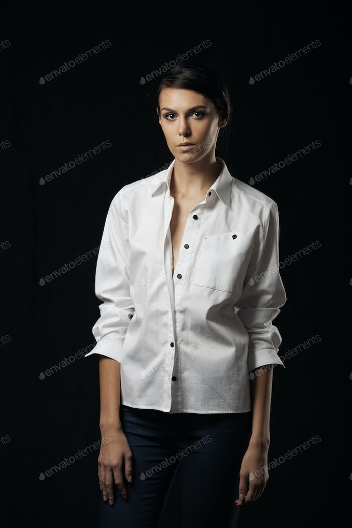 Fashion photo of young magnificent woman in white shirt