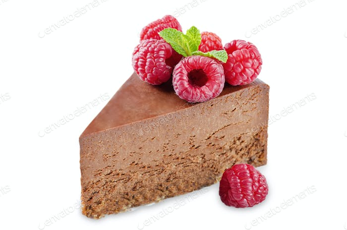 Chocolate cheesecake with fresh berries and mint leaves isolated