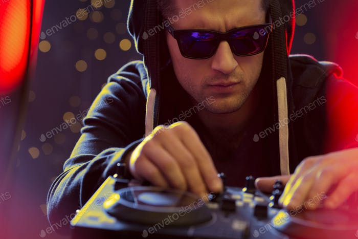 Dj mixing music at party