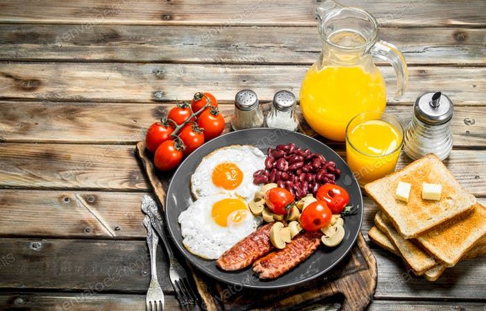 Traditional English breakfast. Fried eggs with beans, sausages and fried bread.