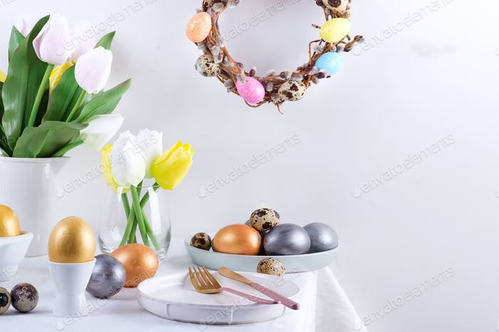 Holiday congratulation composition of served table with handmade painted eggs, baked cookies, fresh