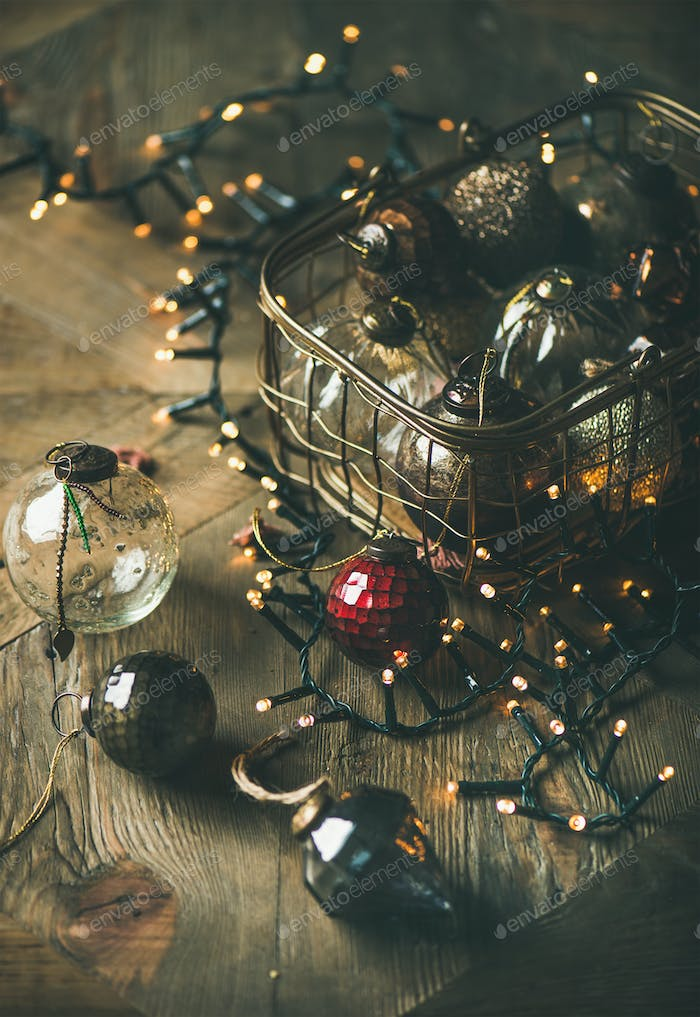Christmas decoration balls in vintage box and light garland
