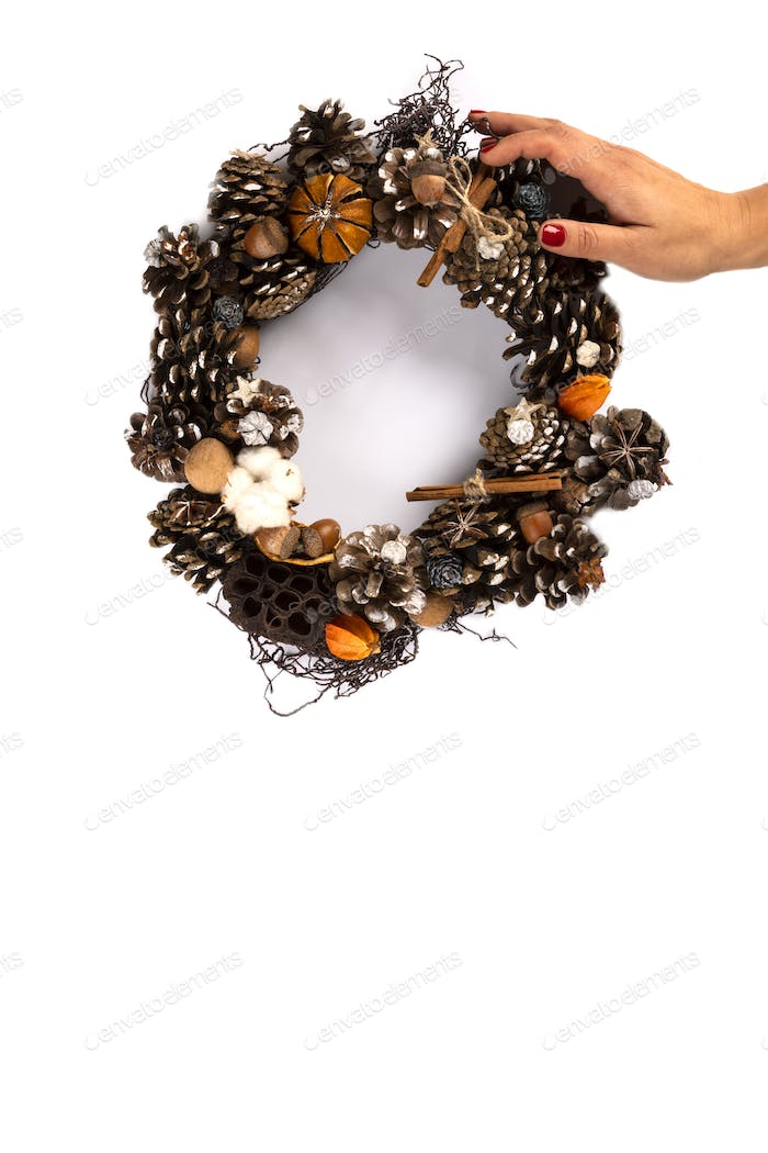 Woman Hands holding Christmas Wreath