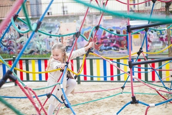 Cheerful girl on playground