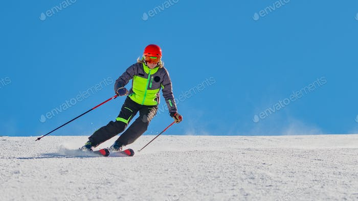 A ski instructor while skiing alone