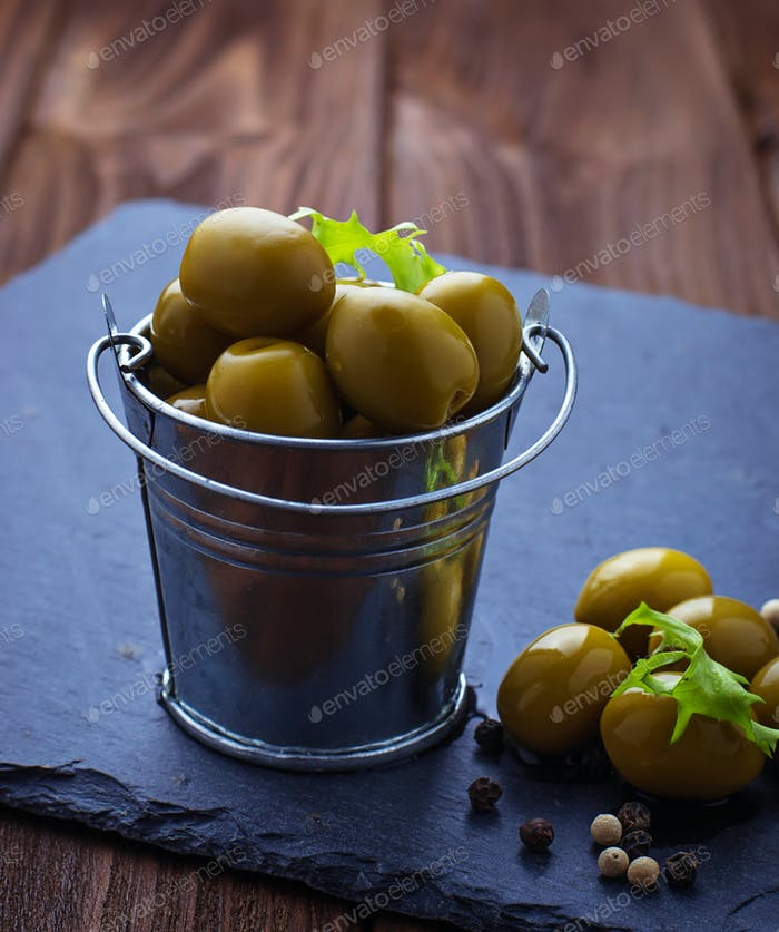 Olives in iron bucket