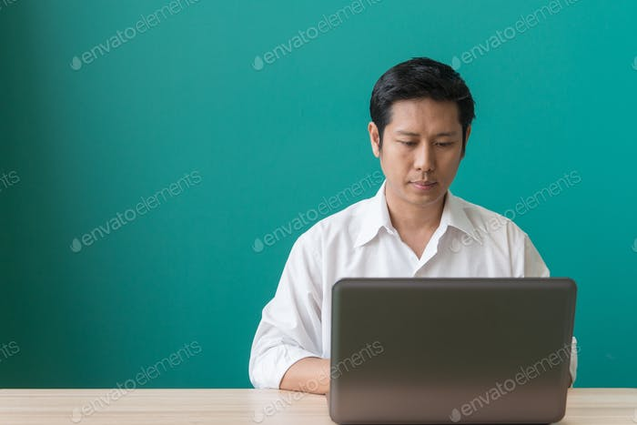 Businessman sitting at a desk using a laptop