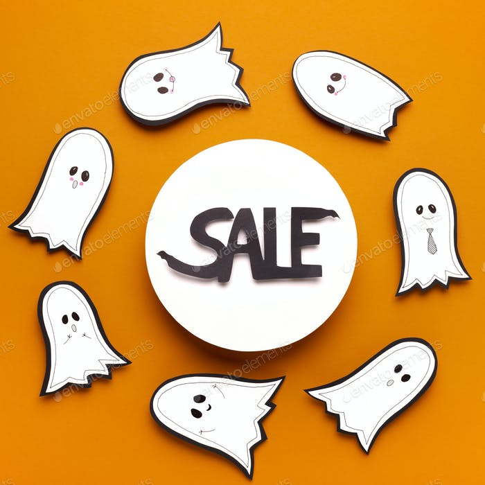 Halloween sales text in frame surrounded by whispering ghosts