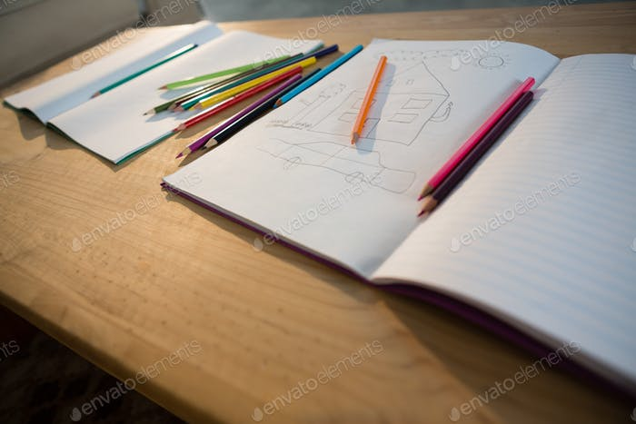 Books and pencils on a table in the living room