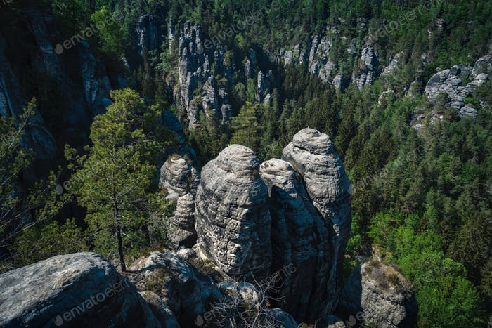 View of famous Bastei rock formation. Elbe Sandstone Mountains. Steep abyss and jutted out rock