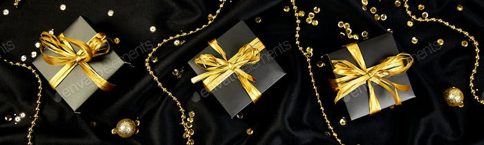 Banner with Luxury black gift boxes with gold ribbon