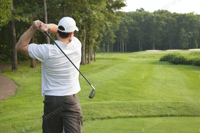 Golfer Tees Off on Golf Hole