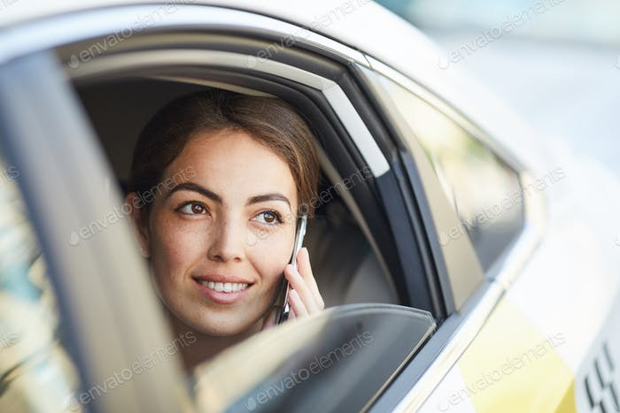 Businesswoman Speaking by Phone in Car