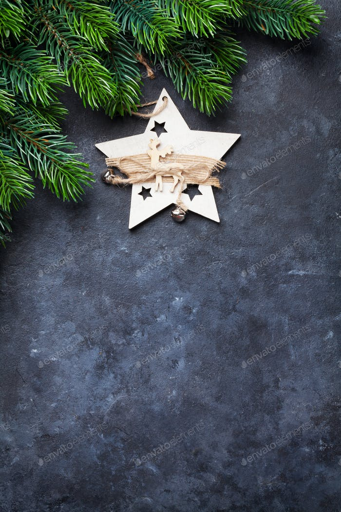 Christmas fir tree and decor over stone background