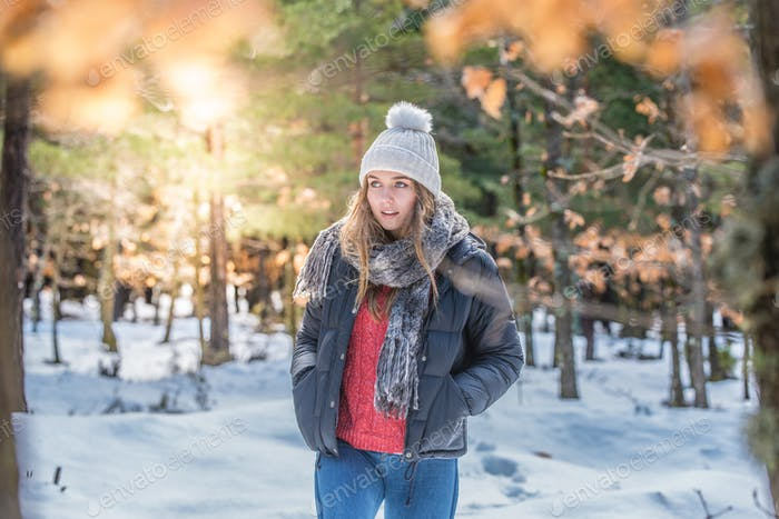 portrait Young pretty woman in winter in the snow