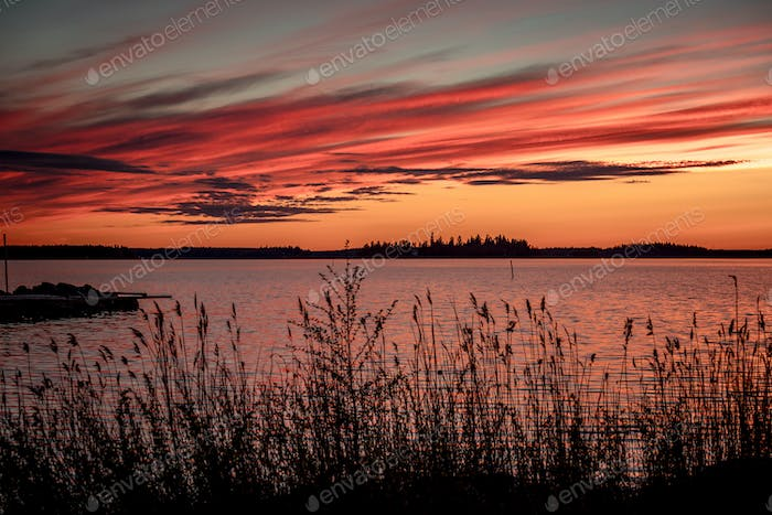 Crimson sunset on the background of the Gulf of Bothnia