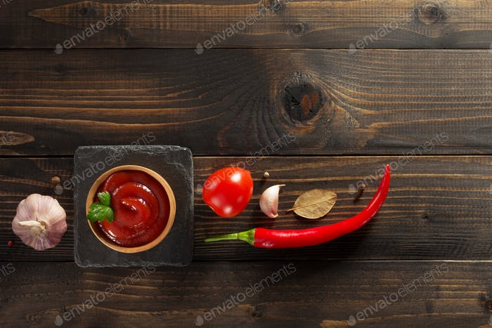 tomato sauce in bowl on wood