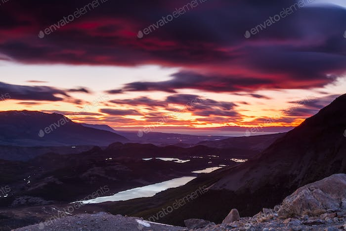 Beautiful mountain scenery on the background of colorful sunset.