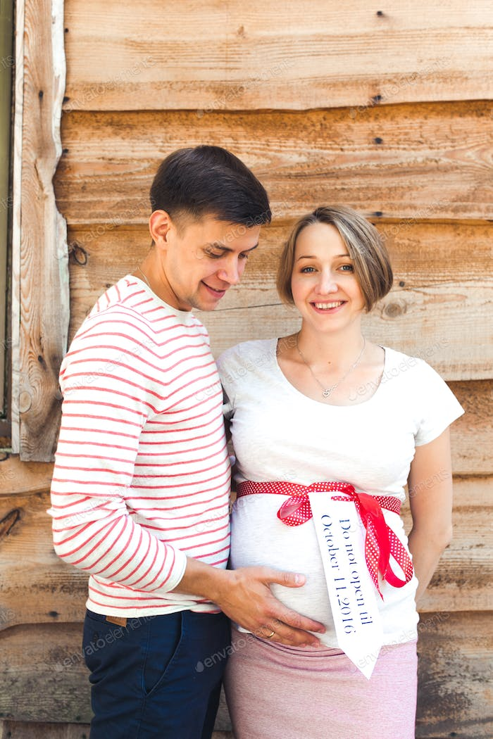 pregnant woman and her husband in the countryside