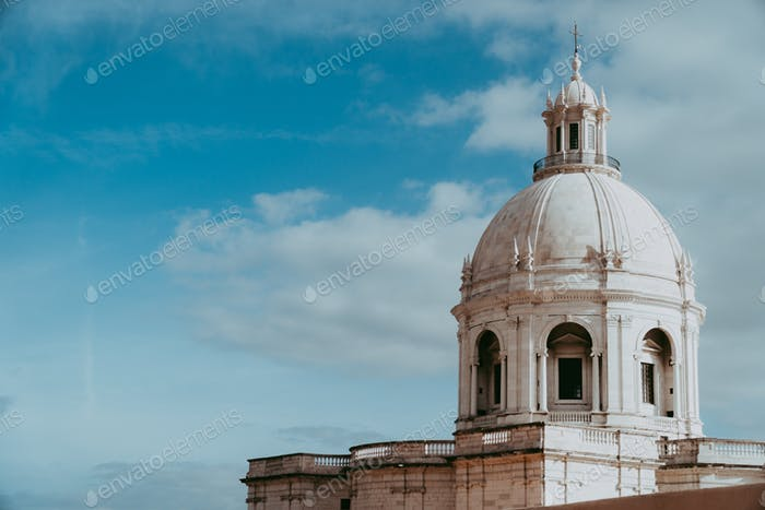 The white cupola of the National Pantheon in Lisbon with blue sky and some clouds in the background