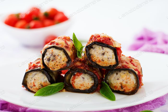 Eggplant (aubergine) rolls with meat in tomato sauce