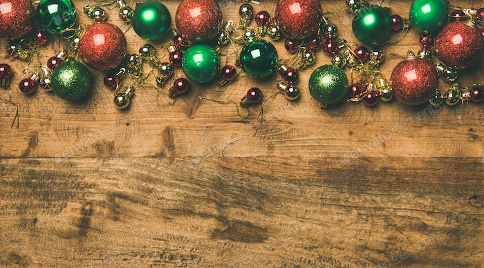 Colorful christmas tree decoration balls on wooden background