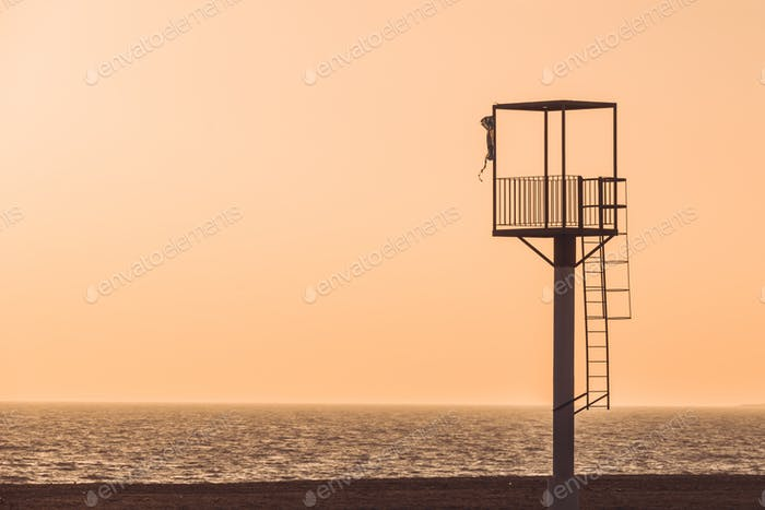 Almerimar beach lifeguard tower at sunset. Deserted beach, no people. Almeria, Andalusia, Spain