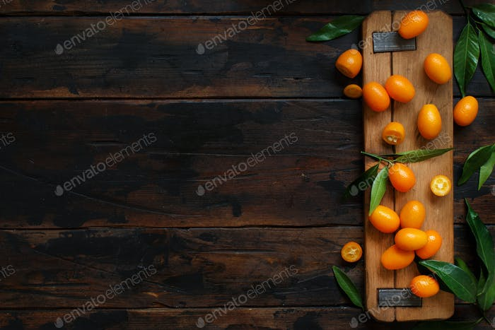 Kumquat fruits on an old wooden  background