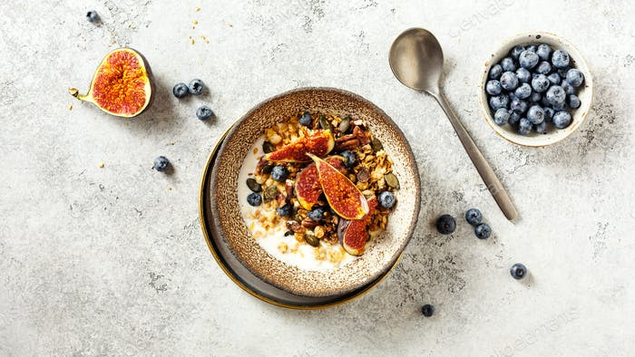 Granola with yogurt, berries and fresh figs. Healthy breakfast