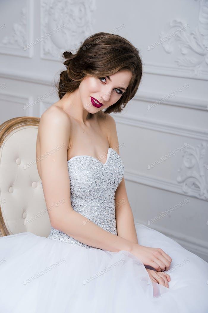 Portrait of beautiful bride. Wedding decoration and dress, white background