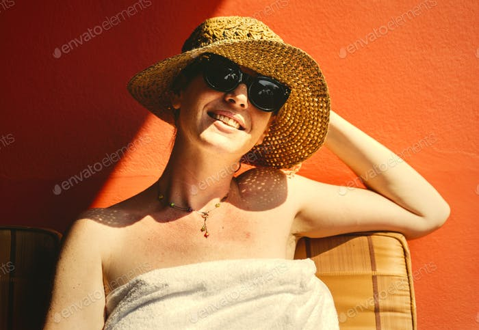 Caucasian woman sunbathing in summertime
