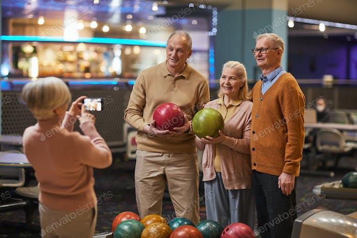 Senior People Taking Photos at Bowling