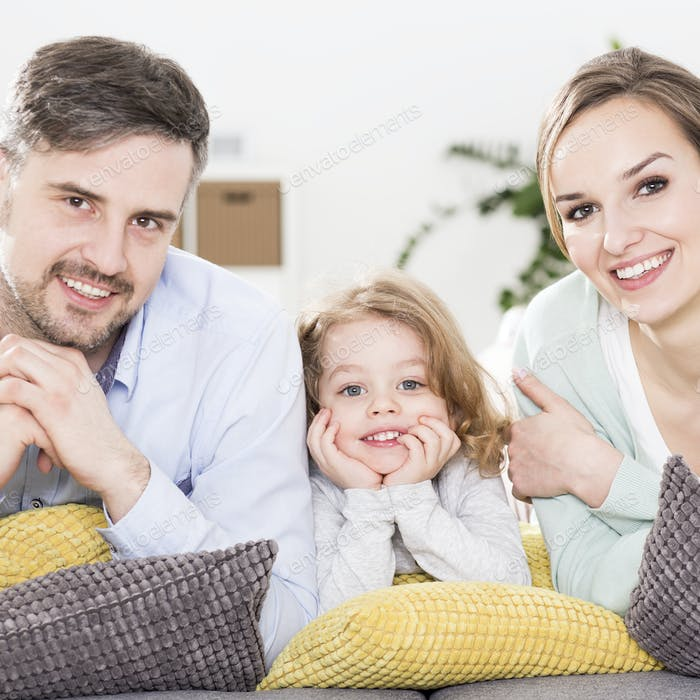 Man, woman and kid relaxing