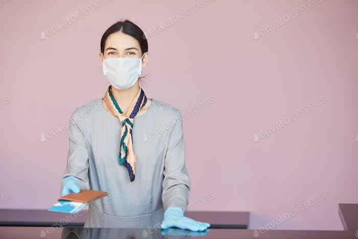 Woman Wearing Mask at Check In Desk in Airport